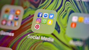 Facebook, Messenger, Twitter, Instagram, WhatsApp, Snapchat and Pinterest social media app icons on a smartphone (Nick Ansell/PA)