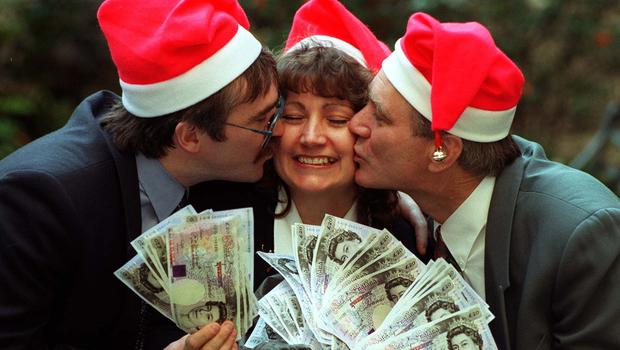 Elaine Thompson celebrating her lottery win with her husband and brother in 1995 (PA)