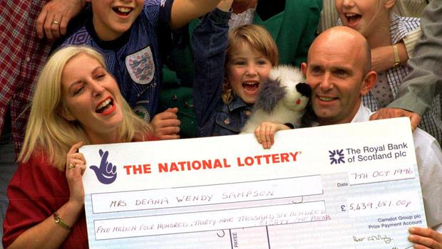 Deana and Colin Sampson with the cheque for their lottery win in 1996 (PA)