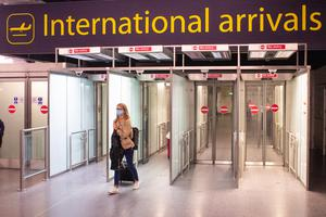 A passenger arrives at Gatwick Airport, following the Government's quarantine ruling on Spain (Dominic Lipinski/PA)