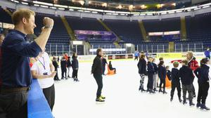 Prince Harry watches skaters during a visit to the National Ice Centre in Nottingham to see the work of the Coach Core programme.
