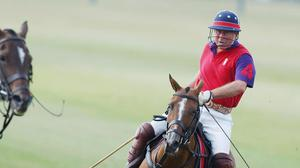 The Prince of Wales playing for Highgrove in a polo matchin 2005 (Barry Batchelor/PA)