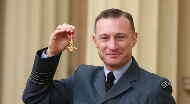 Group Captain Jason Davies received an OBE from the Prince of Wales during an investiture ceremony at Buckingham Palace, London (Jonathan Brady/PA)
