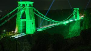 The Clifton Suspension Bridge in Bristol is lit up green for St Patrick's Day (Adam Gasson/PA)
