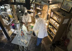 Flour is placed into bags inside the windmill (Danny Lawson/PA)