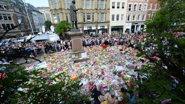 Floral tributes to victims of the Manchester bombing (Ben Birchall/PA)