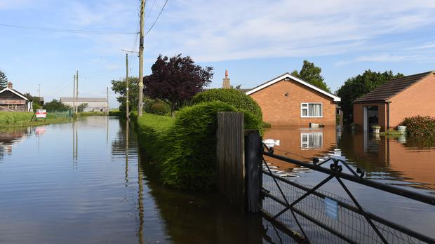 Houses surrounded by flood water on Matt Pitts Lane in Wainfleet All Saints, in Lincolnshire (Joe Giddens/PA)