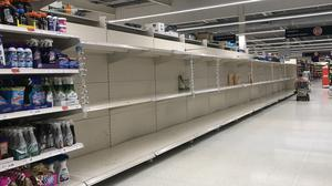 A Sainsbury's supermarket in west Belfast with empty shelves where hand wash and sanitiser would have been (Liam McBurney/PA)