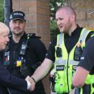 Prime Minister Boris Johnson meeting police (Yui Mok/PA)