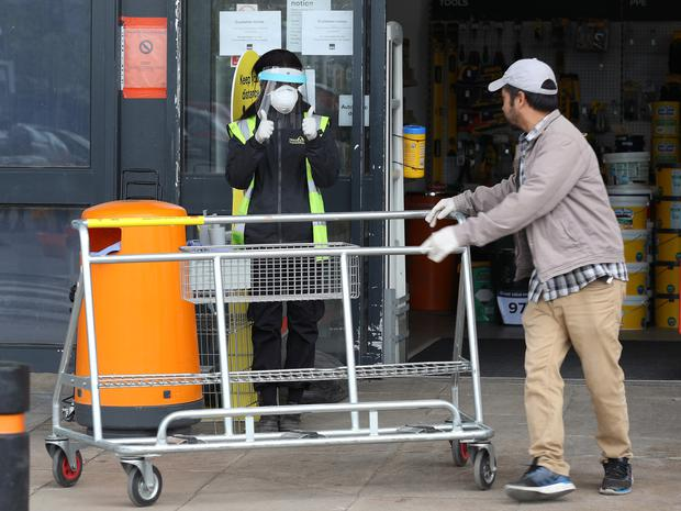 BandQ staff were well protected as they managed the large numbers of shoppers (Yui Mok/PA)