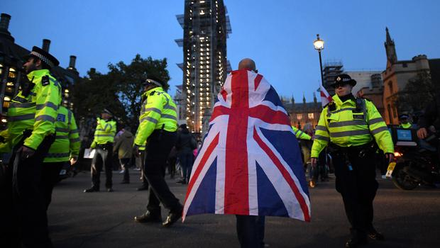Police and Pro Brexit demonstrators (David Mirzoeff/PA)