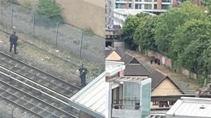 Police were seen on the train tracks in Bow (Dan G/PA)
