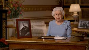 The Queen surrounded by wartime mementos during her VE Day anniversary address (Buckingham Palace/PA)