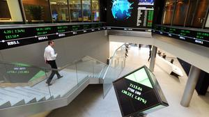 Electronic ticker tape shows the FTSE 100 inside the London Stock Exchange (Nick Ansell/PA)