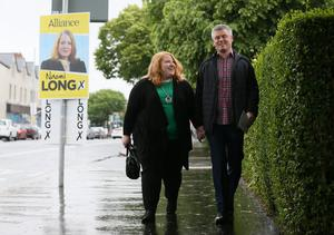 Alliance leader Naomi Long and her husband Michael arriving at St Colmcilles Parish Church, Upper Newtownards Road, Belfast to cast their votes (Brian Lawless/PA)