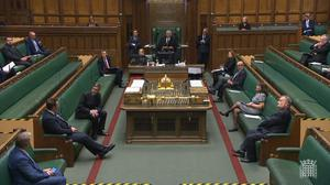 Social distancing markers can be seen on the floor as MPs gathered in the House of Commons (House of Commons/PA)