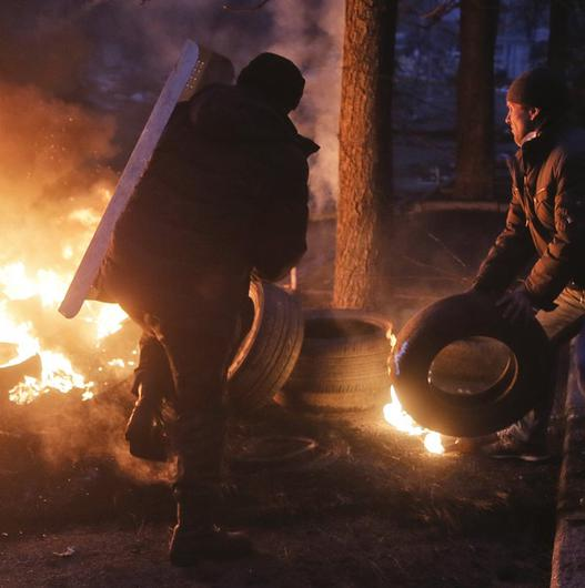 Activists burn tyres at barricades close to Independence Square in Kiev (AP)