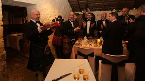 The haggis is carried in at the first Burns supper to be held in Robert Burns' cottage in Alloway, Ayrshire in more than two centuries in 2016 (David Cheskin/PA)