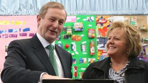 Taoiseach Enda Kenny and his wife Fionnuala cast their votes at a polling station at St Anthony's School in Castlebar, Mayo