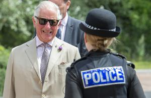 Charles talks to a police officer (Paul Grover/Daily Telegraph/PA)