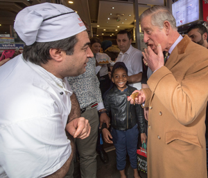 Prince Charles samples some baklava in Leicester