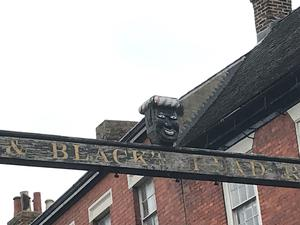The sign at the Greenman pub in Ashbourne, Derbyshire, before the head was removed (PA)