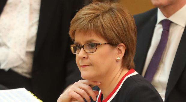 First Minister Nicola Sturgeon in the debating chamber during First Minister's Questions at the Scottish Parliament in Edinburgh (Andrew Milligan/PA)