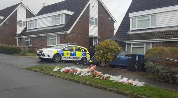 Floral tributes left for the victims in Hazel Way, Crawley Down, West Sussex (Helen William/PA)
