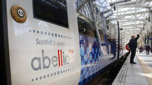 A ScotRail train operated by Abellio at Glasgow Central Station in Scotland (Danny Lawson/PA)