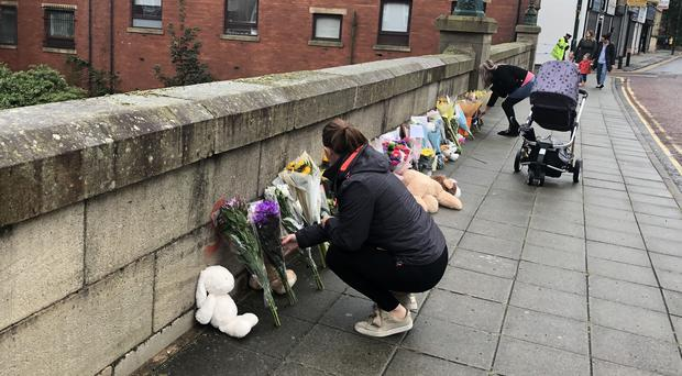 Floral tributes are left on a bridge in Radcliffe, Greater Manchester following the death of a baby boy (Kim Pilling/PA)