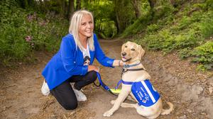 Deana Sampson, who won £5.4m on the lottery weeks after she lost her brother to epilepsy, is spending lockdown training golden Labrador Regis as a disability assistance dog to help others with physical needs (Anthony Devlin/PA)