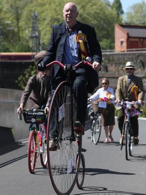 Some cyclists had a lofty view as they crossed Somers Town Bridge spanning London's Regent's Canal (Jonathan Brady/PA)