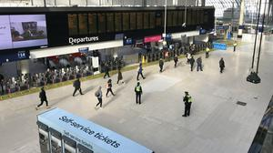 Commuters at Waterloo Station during rush hour on Monday morning (Luke Powell/PA)