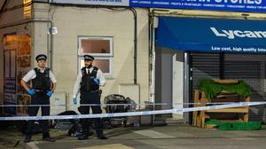 Police at the scene in Aldborough Road North, Ilford (Dominic Lipinski/PA)
