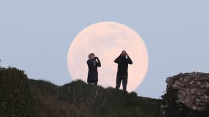 The pink supermoon seen in Ireland (Niall Carson/PA)