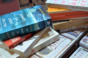 Start a virtual book club with friends (Hannah McKay/PA Archive)