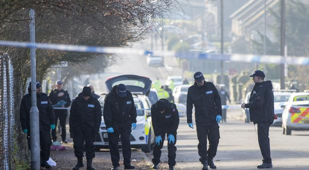 Police search teams make their way along Willingale Road in Loughton, Essex, near to Debden Park High School (Rick Findler/PA)