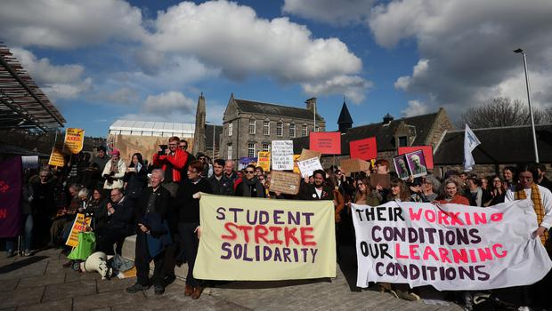 University staff joined by politicians and students at a protest outside the Scottish Parliament (Jane Barlow/PA)