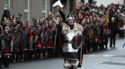 Guizer Jarl Liam Summers with members of the Jarl Squad march through Lerwick on the Shetland Isles during the Up Helly Aa Viking festival (Andrew Milligan/PA)