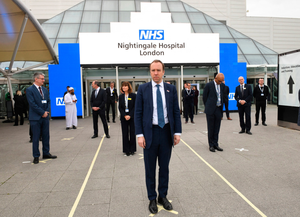 Health Secretary Matt Hancock and NHS staff stand on social distancing marks at the opening of the NHS Nightingale hospital at the ExCel Centre in London