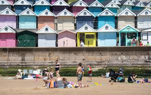 People enjoying the good weather on the beach at Walton-on-the-Naze in Essex (PA)