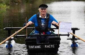 Michael Stanley, also known as 'Major Mick', sets off from Hunston, West Sussex, to row along the Chichester canal (Andrew Matthews/PA)