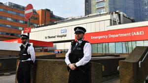 Police officers outside St Thomas' Hospital where Prime Minister Boris Johnson remains in intensive care (Dominic Lipinski/PA)