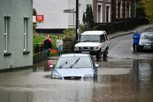 A car stranded in floodwater in Tonna near Aberdulais, Neath (Ben Birchall/PA)