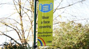 A sign telling people to wear a face covering in Nottingham, where Tier 3 coronavirus restrictions are being imposed (PA)