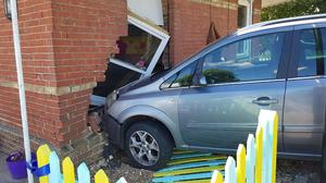 The crash left a gaping hole in the wall of the nursery (Sussex Police/PA)