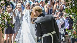 The Duke and Duchess of Sussex kiss at they leave St George's Chapel on their wedding day in 2018 (Danny Lawson/PA)