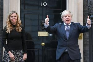 Boris Johnson and partner Carrie Symonds pay tribute in Downing Street (Victoria Jones/PA)