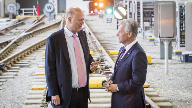 Transport Secretary Chris Grayling spoke with chief executive of Network Rail Mark Carne during a visit to the Rail Operating Centre in York (Danny Lawson/PA)