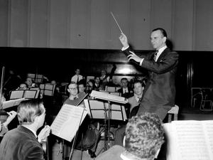 Sir Malcolm Sargent in inimitable style, leading members of the London Philharmonic Orchestra (PA Archive/PA Images)